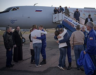 Soyuz MS-10 - Launch vehicle, plume from escape tower, 4 boosters, and debris after separation (left) and the crew greeting their families in Baikonur hours after landing (right).