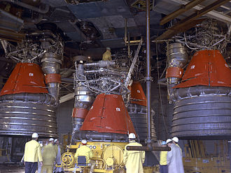 Rocketdyne F-1 - Installation of F-1 engines to the Saturn V S-IC Stage. The nozzle extension is absent from the engine being fitted.