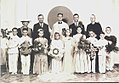 Father Emil Kapaun (center) poses for a picture with members of his congregation after celebrating his first mass as a priest at St. John Nepomucene Church in Pilsen, Kan., in 1940 130404-A-DU775-869.jpg
