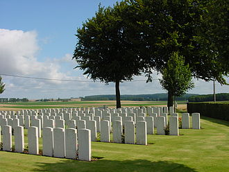Bourlon Wood Memorial - Bourlon wood is seen in the background of Flesquières Hill British Cemetery.
