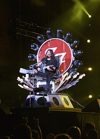 Dave Grohl - Grohl performing with a broken leg at Fenway Park in July 2015