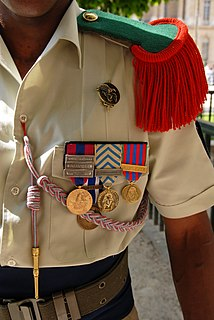 braided cord worn on military uniforms, especially in France, awarded as an honorary decoration