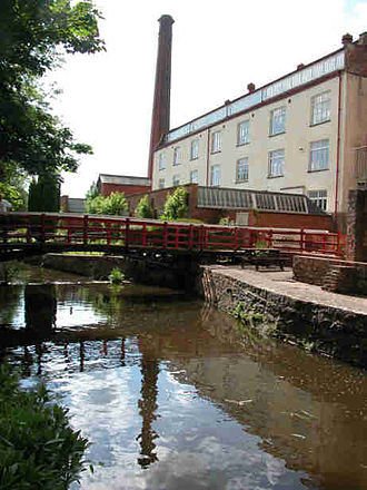 Coldharbour Mill Working Wool Museum - Coldharbour Mill in 2009, viewed from the middle leat. The construction of the main building started in 1799.