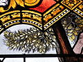 Fr Chapelle Notre-Dame-de-Lhor Saint Anthony the Great stained glass - tree detail.jpg