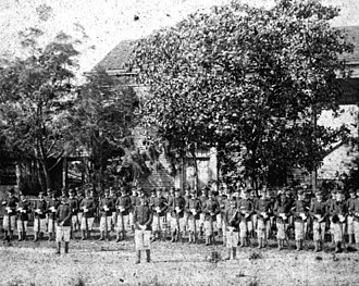 Franklin Guards - Franklin Guards standing next to David G. Raney's house in Apalachicola, Florida. Taken approx. 1890s.