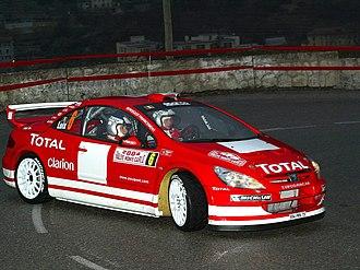 Freddy Loix - Loix driving a Peugeot 307 WRC.