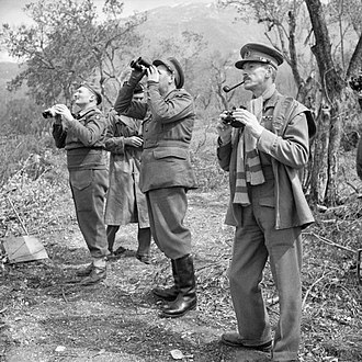 Sidney Kirkman - Lieutenant General Leese, GOC Eighth Army, with his corps commanders, including Kirkman, GOC XIII Corps, standing closest to the camera, watching an Allied bombing raid on Cassino, Italy, 15 March 1944.