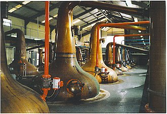 Whisky - The production of whisky from barley to bottle (top), swan necked copper stills in the Glenfiddich distillery (bottom)