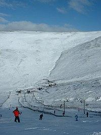 Glenshee ski area showing snow fences besides pistes & lifts