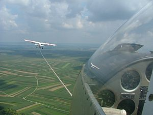 Takeoff - Tow line and towing aircraft seen from the cockpit of a glider