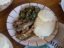 Typical Zimbabwean Meal, With Sadza, Greens And Goat Offal U0027Zvinyenzeu0027 In  Shona. The Goat Intestines Are Wrapped Around The Stomach Before Cooking.