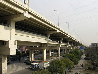 North–South Elevated Road (Shanghai) - The North-South Elevated Road at West Changjiang Road. Shanghai Metro Line 1 runs on the first level above the street, and the expressway runs on the second level above the street.
