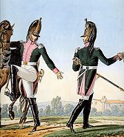 Print of two troopers of the 16th Dragoon Regiment wearing green coat with pink facings and white breeches with black riding boots.