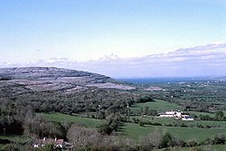 Gregan's Castle Hotel (mid-foreground) and the valley to Ballyvaughan from Corkscrew Hill, the Burren. The hill of the left (west) is Cappanawalla.
