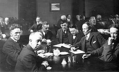 The Group of Seven with Barker Fairley (fourth from left), Arts and Letters Club, Toronto, 1920.