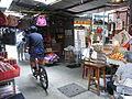 HK CWB Jardine's Crescent morning outdoor market stalls bike rider Aug-2012.JPG