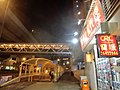 HK Ma On Shan 西沙路 Sai Sha Road 富輝花園 Fu Fai Garden shop property agent sign view footbridge Dec-2013 covered walkway night.JPG