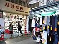 HK Mong Kok Fa Yuen Street evening sidewalk shop n clothing stall Sept-2012.JPG