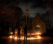 on all hallows eve christians in some parts of the world visit graveyards to pray and place flowers and candles on the graves of their loved ones