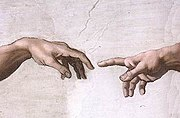 The iconic image of the Hand of God giving life to Adam.