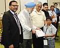 """Hardeep Singh Puri presenting the certificates to the Divyang students from special schools participated in the painting competition, at the World Habitat Day 2017 function, on the theme """"Housing Policies Affordable Homes"""".jpg"""