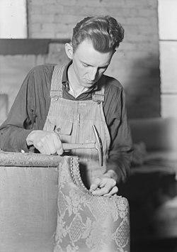 High Point, North Carolina - Upholstering. Tomlinson Chair Manufacturing Co. Decorative nail trim - (Brass rails... - NARA - 518474 (cropped).jpg