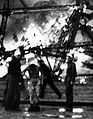 Hindenburg survivor sheds burning clothes 1937.jpg