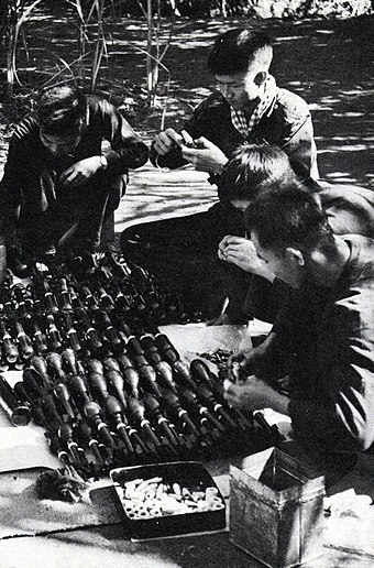 Guerillas assemble shells and rockets delivered along the Ho Chi Minh Trail. HoChiMinhTrail003.jpg