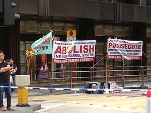 Million People March - OFWs in Hong Kong's Central district sit near protest signs in Hong Kong.