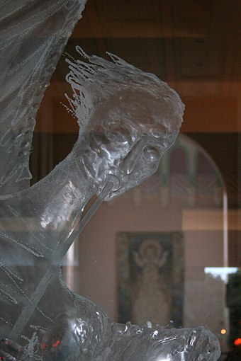 One of the Hutton glass angels; the dossal is visible through the glass HuttonGlassWCSP.jpg