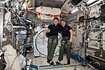ISS-59 Anne McClain and Christina Koch pose for a portrait inside the Kibo lab.jpg