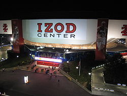Meadowlands Arena as seen from a nearby parking garage, following its re-branding as the Izod Center. The banner displaying the arena's name was taken down and replaced with a permanent sign, which was subsequently removed from the building when it closed.