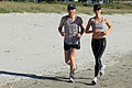 Ian and Susan jogging on Maunganui beach 3 (5644495596).jpg