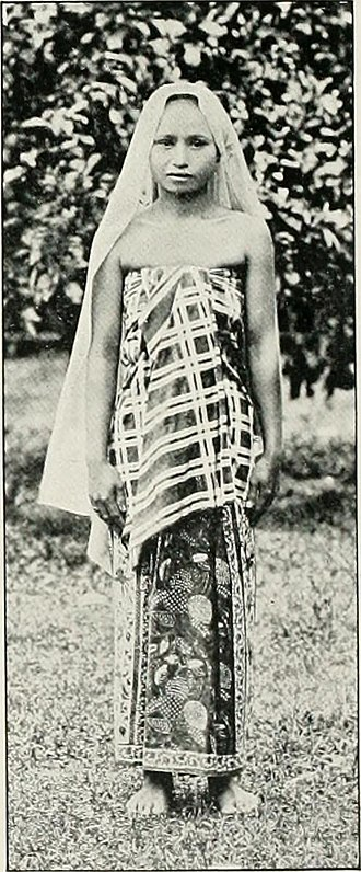 Kelantanese Malay people - Dressed in flowered sarong and with a Kelantanese style of check pattern kain lepas.