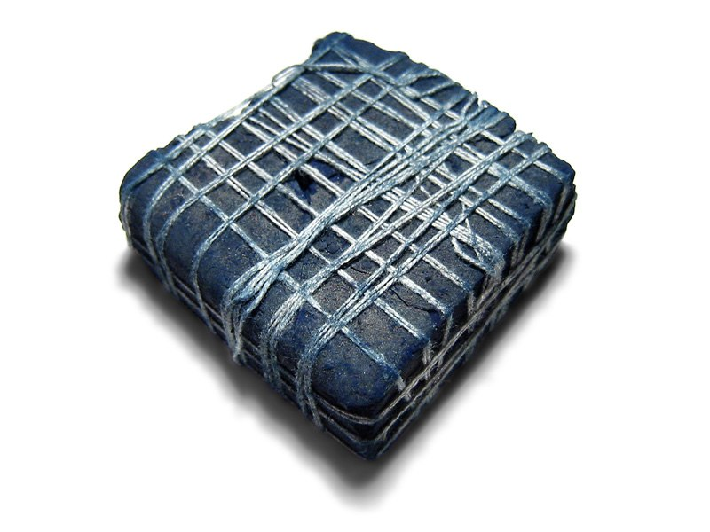 Piece of indigo plant dye from India, c. 2.5 inches (6.35 cm) square.
