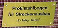 Inschrift am Profilstahlbogen über der Barbarastatue in Buggingen.jpg