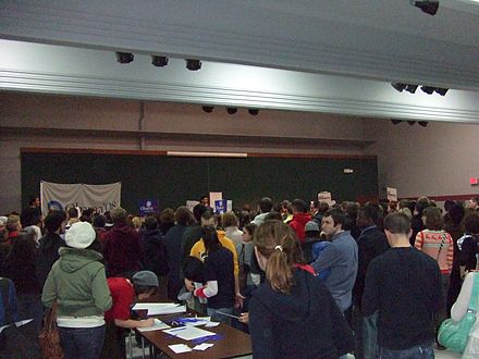 A 2008 Democratic caucus meeting in Iowa City, Iowa. The Iowa caucuses are traditionally the first major electoral event of presidential primaries and caucuses. Iowa City Caucus.jpg