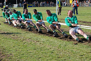 Tug of war sport in which two teams pull on opposite ends of a rope