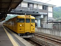 JNR 115 Setouchi yellow livery at Bitchu-Takahashi Station 20120506.jpg