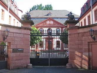 François Français - Hotel of the Order of the Holy Sepulcher, Mainz. Chain-covered ball bombs, from which flames strike, are located at the entrance gate as an allegory for the French artillery school, where François Français was teaching.