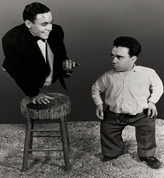 Angelo Rossitto - Angelo Rossitto, right, aged 24 in Tod Browning's Freaks. Fellow performer Johnny Eck is on the left.