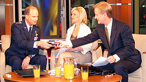 Kevin P. Chilton - Chilton handing a GPS receiver to Steve Doocy during an interview with Fox & Friends