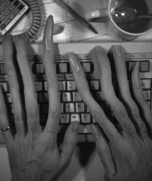 Slit-scan photography - Example of slit-scan technique (self portrait while typing on computer keyboard).  Camera is rotated into portrait orientation, and slit scan that would originally run left-to-right now runs top-to bottom