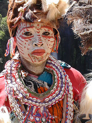 Kikuyu woman with face painted white and red, ...