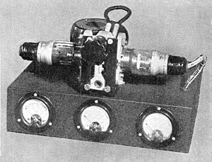 Klystron - Klystron oscillator from 1944. The electron gun is on the right, the collector on the left.  The two cavity resonators are in center, linked by a short coaxial cable to provide positive feedback.