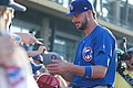 Kris Bryant signing autographs during his rehab assignment against Omaha (42507322120).jpg