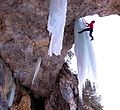 Kristoffer Szilas climbing a mixed route graded M9.JPG