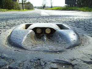 Road surface marking - The cat's eye, showing the iron base, rubber housing and lenses