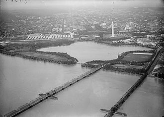 Highway Bridge (left) and Long Bridge in 1919 LONG BRIDGE. AIRPLANE VIEW OF, WITH TIDAL BASIN, MONUMENT.jpg