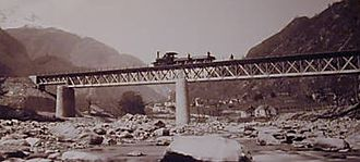 Gotthard railway - Lower Ticino Bridge during construction phase, with its original single beam truss structure